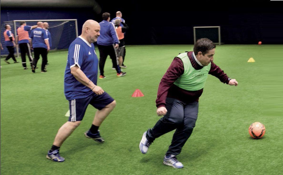 Bild austauschen_Krebsprävention_Fußballfans im Training